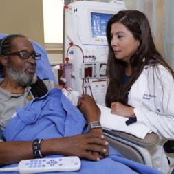 Adriana Hung, MD, MPH, talks with patient Sylvester Norman, who is participating in the VA Department's Million Veteran Program. (Photo by Brandon Lunday)